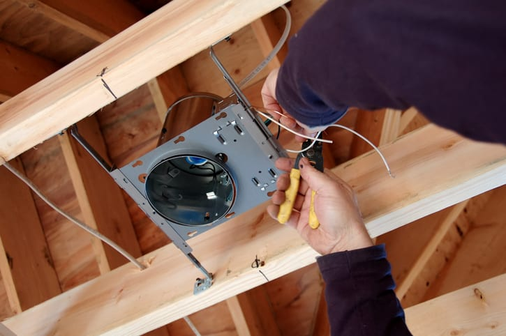 Electrician installing lightbox